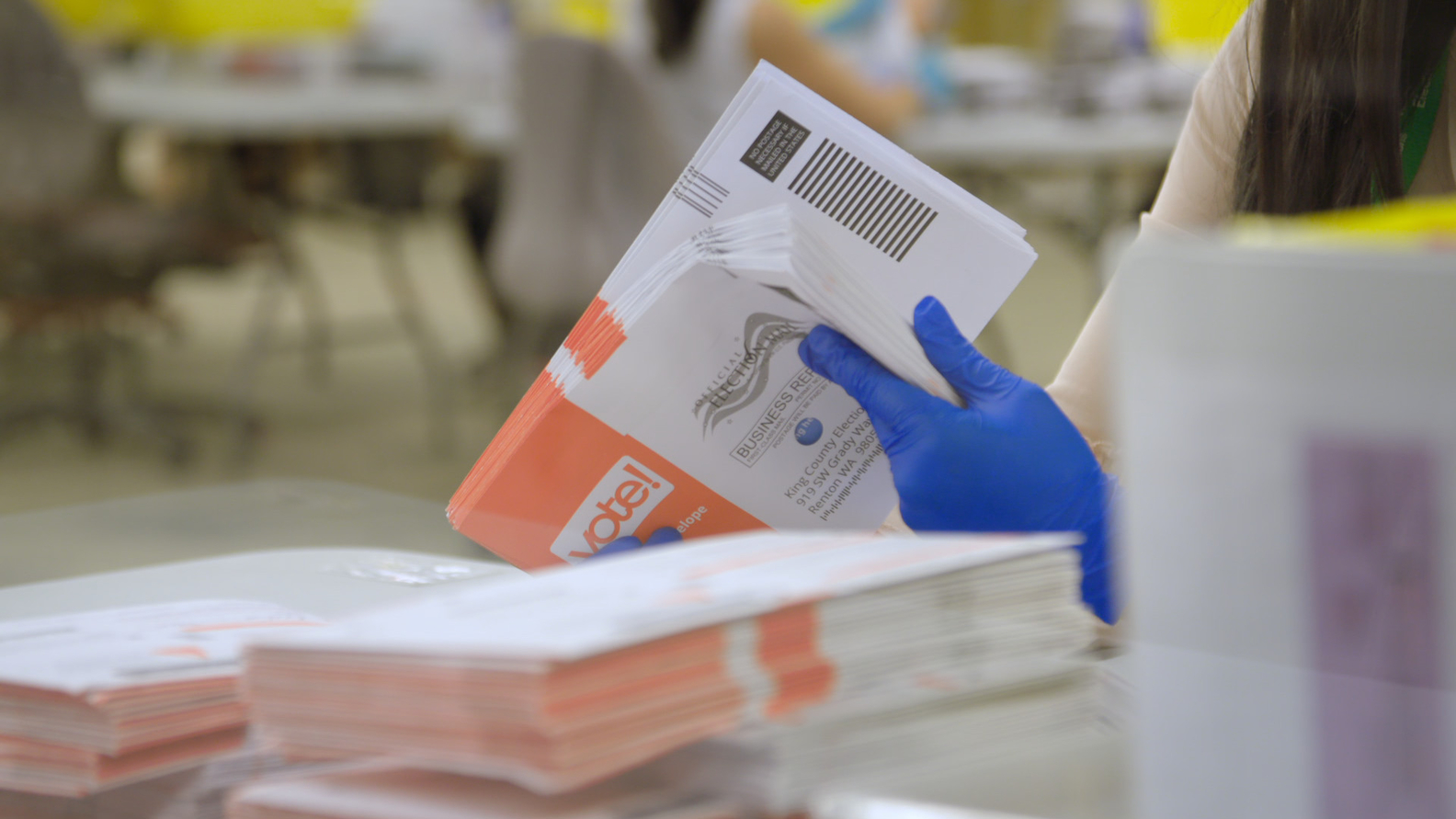 Mail-in ballots being processed during Washington state's primary election