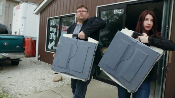 Harri Hursti and Maggie MacAlpine carry voting machines they purchased