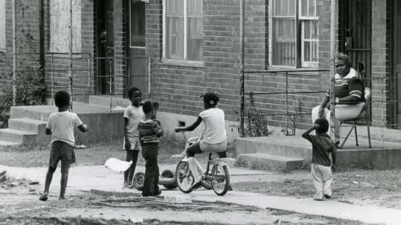 Children playing outside Capitol Homes Housing Project