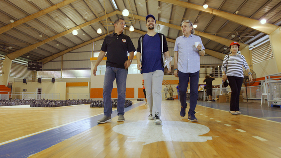 (center) Lin-Manuel Miranda with his father, Luis Miranda (right) and mother, Dr. Luz Towns-Miranda (far right) assisting with disaster relief efforts in Puerto Rico