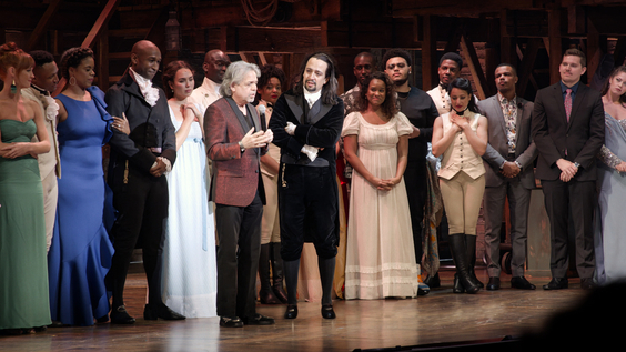 Luis Miranda (center left), on stage with his son Lin-Manuel Miranda (center right) after Hamilton debuted in Puerto Rico