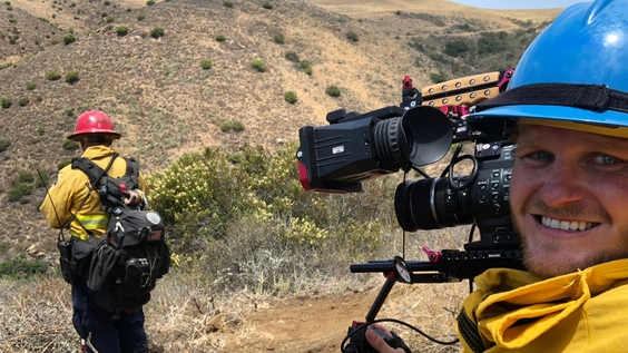 Director Michael Milano with a firefighter in Ojai