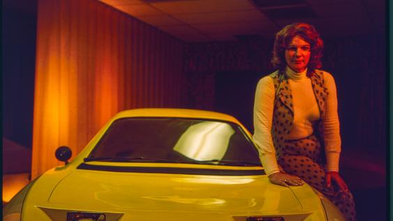 Elizabeth Carmichael posing next to the Dale automobile