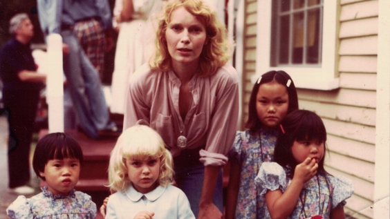 Mia Farrow (center) with her children (from left) Daisy, Fletcher, Soon-Yi, and Lark