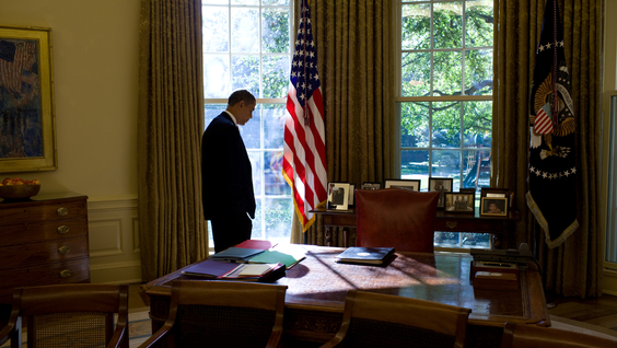 """President Barack Obama """"The light was streaming through the window, and I was trying to catch him walking back to his desk between meetings and phone calls"""" - Official White House Photo by Pete Souza"""