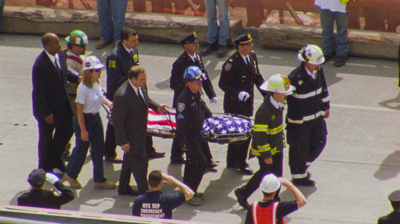 Rescue workers recovering a body from 9/11 Ground Zero